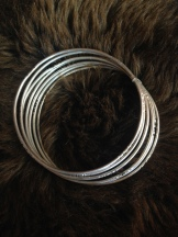 7 bangle bracelets (sold as set only) $75